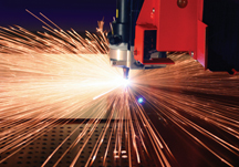 Cutting laser in action. Laser safety in cutting applications is key to worker safety.